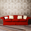 Modern interior design of living room with a red sofa — Stock Photo #5747463