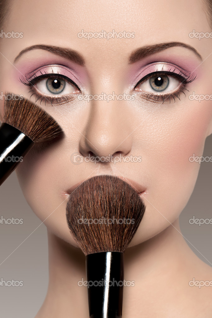 Portrait Of A Beautiful Woman With A Make Up Brush Stock