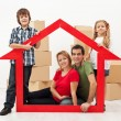 Family in their new home concept — Stock Photo #19146813