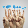 Happy group of finger smileys with social chat sign and speech bubbles — Stock Photo #8251039
