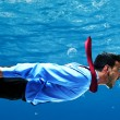 Businessman swimming underwater — Stock Photo #34714719