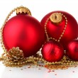 Beautiful red Christmas balls and cones isolated on white — Stock Photo #29302079