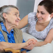 Senior woman with her home caregiver — Stock Photo #6867479
