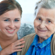 Senior woman with her home caregiver — Stock Photo #6867660