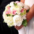 Bride holding a bouquet — Stock Photo #7372736