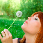 Woman with dandelion — Stock Photo #7620001