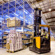 Worker on forklift — Stock Photo #11725492