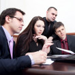 Businesspeople at a meeting in the office — Stock Photo #9484908