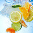 Fruits are falling under water with a splash — Stock Photo #9266978