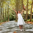 Full length portrait of young violinist in woods. — Stock Photo #13251779