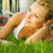 Beautiful healthy Young Woman relaxing on the green grass — Stock Photo #10603823