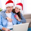 Christmas Online Shopping. Couple Using Credit Card to E-Shop — Stock Photo #16276071