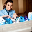 Working staff arranging toiletries in a wheel cart — Stock Photo #13537757