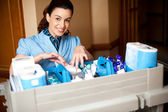 Working staff arranging toiletries in a wheel cart — Stockfoto