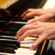 Hand of a piano player — Stock Photo #9975258