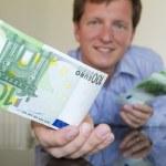 Giving 100 Euro — Stock Photo #26735831