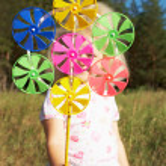Pinwheel in hand — Stock Photo #11628114