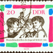 """GERMAN DEMOCRATIC REPUBLIC - CIRCA 1964: A stamp printed in Germany from the """"German Youth Meeting, Berlin"""" issue shows Young gymnasts, circa 1964. — Stock Photo #44258547"""