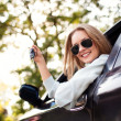 Young woman shows the keys to her new car — Stock Photo #11983540