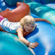 Girl playing on an inflatable toy — Stock Photo #11672367