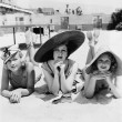 Portrait of three young women lying on the beach — Stock Photo #12295213