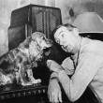 Man and dog listening to the radio — Stock Photo #12298316