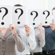 Business team behind question marks — Stock Photo #12766955