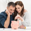 Couple Saving Money — Fotografia Stock  #39422979