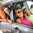 Hispanic family in a car. Family tour in a car. — Stock Photo #14397769