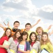 Group of smiling teenagers staying together — Stock Photo #25309845