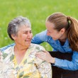 Elderly woman and her daughter — Stock Photo #25496483