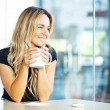 Woman drinking coffee in the morning at restaurant — Stock Photo #25560509