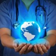Medical Doctor holding a world globe in his hands as medical net — Stock Photo #21854543