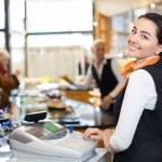 Salesperson at cash register — Stock Photo #41025697