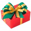 Red gift box with green and gold bow tie — Stock Photo #31774725