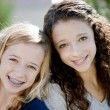 Two smiling caucasian teenage girls in the park — Stock Photo #21366719