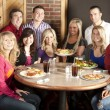 Waist up image of eleven adults at a restaurant — Stock Photo #21370019