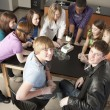 School Science. High school students looking at different specimens in their school science or biology class — Stock Photo #21370411