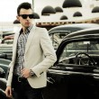 Young handsome man, model of fashion, wearing jacket and shirt w — Stock Photo #19284723
