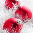 Red christmas baubles — Stock Photo #32527663