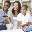 African American Family Watching Television With Remote Control — Stock Photo #21710347