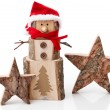 Wooden Christmas decoration: stars and santa hat on white background — Stock Photo #34627027