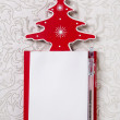 Christmas wishlist: white and red writing pad with a tree. — Stock Photo #50934251