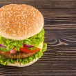 Homemade burger on the wooden table — Stock Photo #44276667