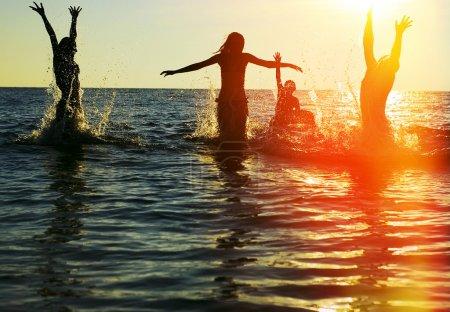 people jumping in ocean
