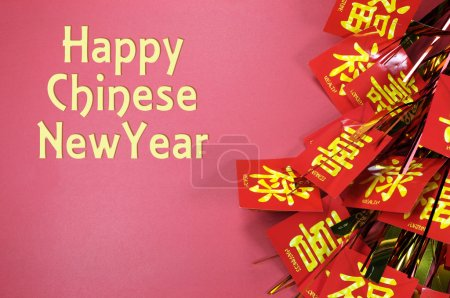 Happy Chinese New Year text greeting with traditional decorations on red background.