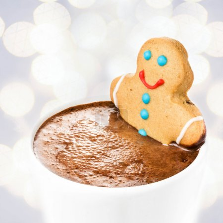 Gingerbread cookie man take a bath in cup of Hot Chocolate